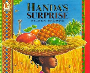 A colourful image of a woman with a fruit basket on her head. There is text saying 'Handa's Surprise.'